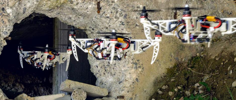 The new drones can retract their propeller arms in flight, making themselves small to fit through narrow gaps and holes. Image Credit: UZH