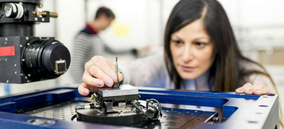 woman preparing machine in lab