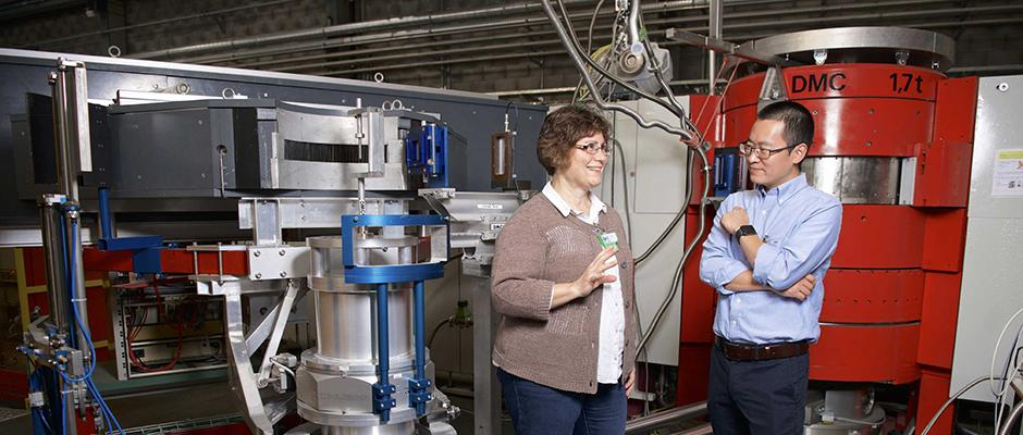 Marisa Medarde and Tian Shang at the neutron diffractometer DMC.  Image Credit: Paul Scherrer Institute/Markus Fischer