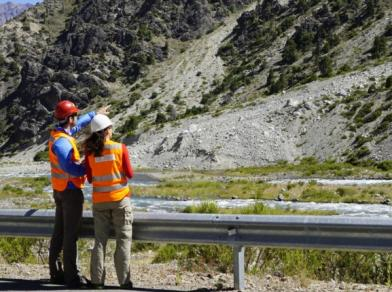 Two engineers look at the Chilean mountains