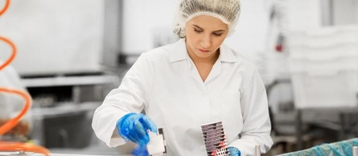 Woman working in food factory