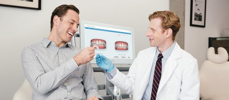dentist and patient with aligner