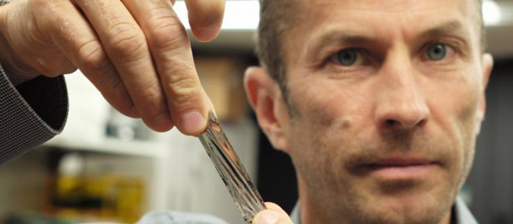 IBM scientist Mark Lantz holds a piece of magnetic tape.