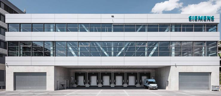 The front side of the new production facility in Zug. Image Credit: Siemens