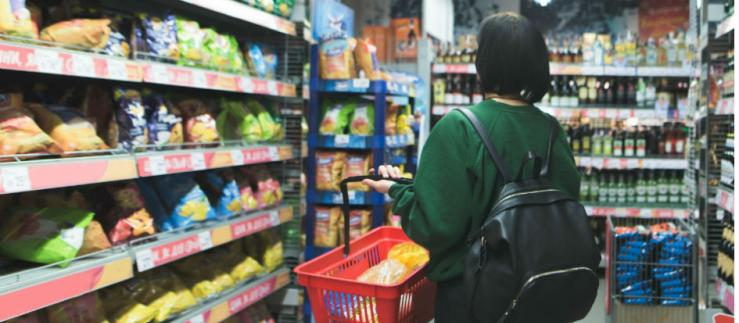 A woman buying chips