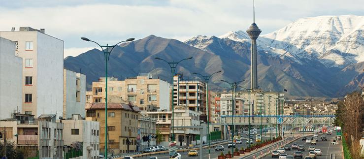 View of a street in Tehran with the Azadi Tower in the background