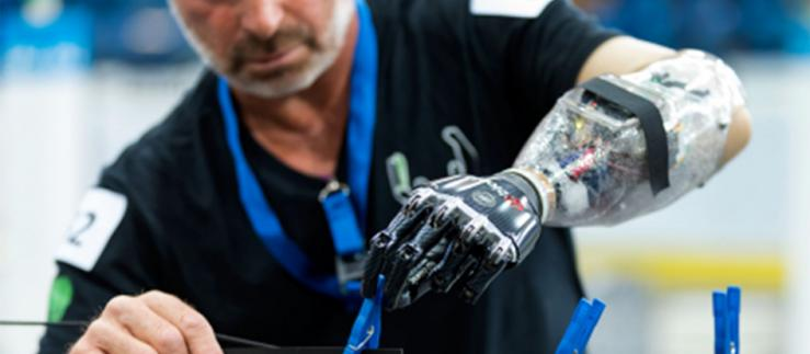 Scientist working with a robot hand.
