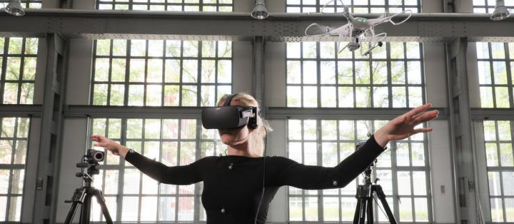 Woman with VR goggles and drone