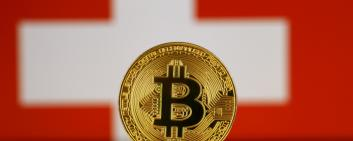 Physical version of Bitcoin and Switzerland Flag.