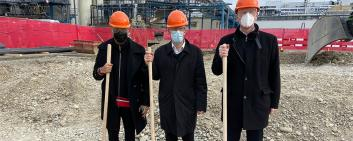RN Laboratories owner Nitin Garg, site manager Urs Haller and Dr. Guido Zimmermann, CEO of GETEC Park.Swiss, give the starting signal for the construction work.