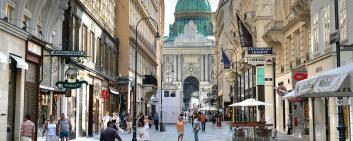 Church and shopping alley in Vienna, Austria